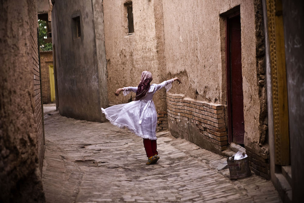 A girl dances in old city in Kashgar, China, May 6, 2009.   Inquire about this image
