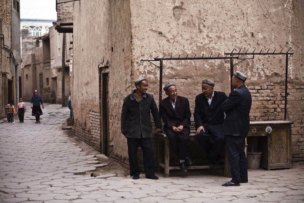 Residents pass time in old city in Kashgar, China, May 6, 2009.    Inquire about this image
