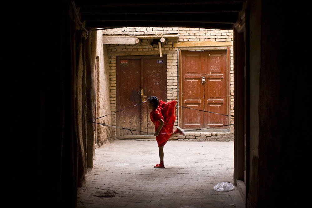 A girl plays in old city in Kashgar, China, May 5, 2009.   Inquire about this image