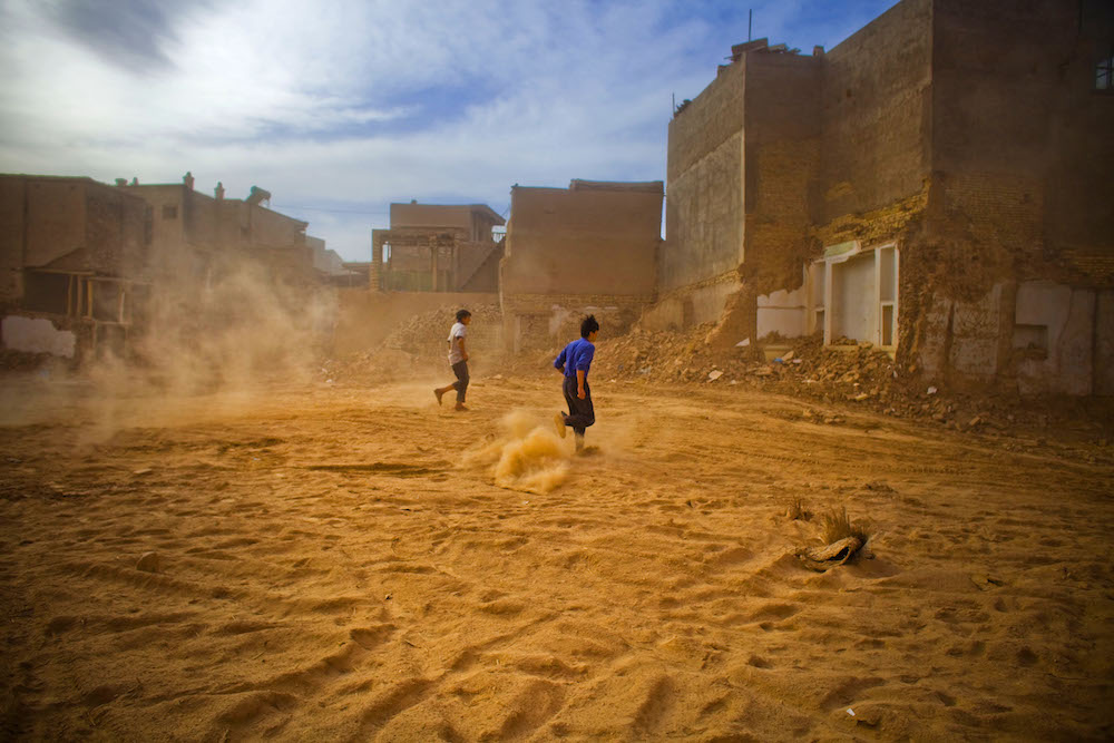 Residents make their way through demolishing site in old city in Kashgar, China, May 6, 2009.   Inquire about this image