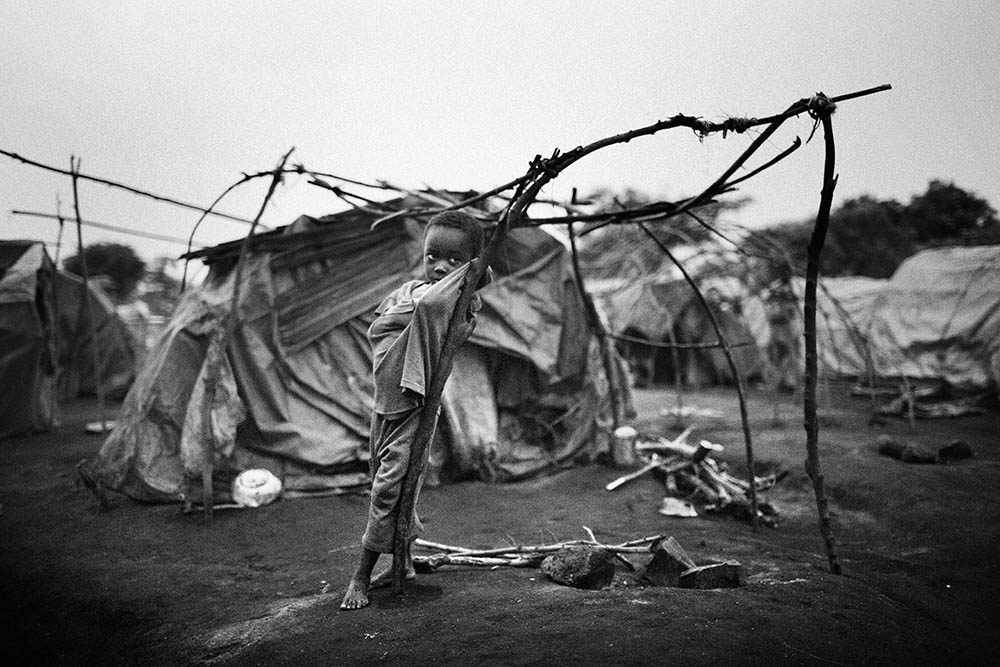 Opangi Molati, five, in Tchomia camp after being displaced by nearby fighting. Around 30,000 displaced people live in this area with limited supplies and virtually no international help. 2006.  Inquire about this image