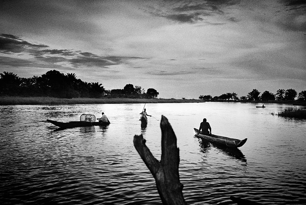 Displaced people fish in the evening on the Congo River outside Nyonga, Katanga province. 2005.  Inquire about this image