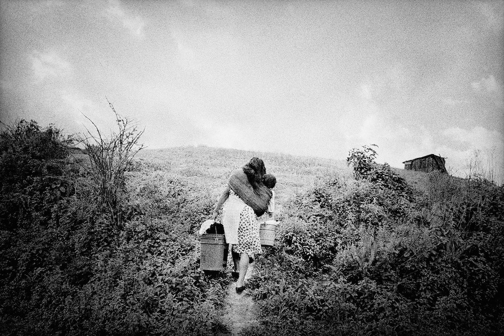 A mother returns home. San Miguel Cuevas, Mexico. 2000.  Inquire about this image