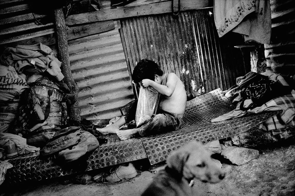 A boy inside his family's tin house. Santiago Mitlatongo, Mexico. 2012.  Inquire about this image
