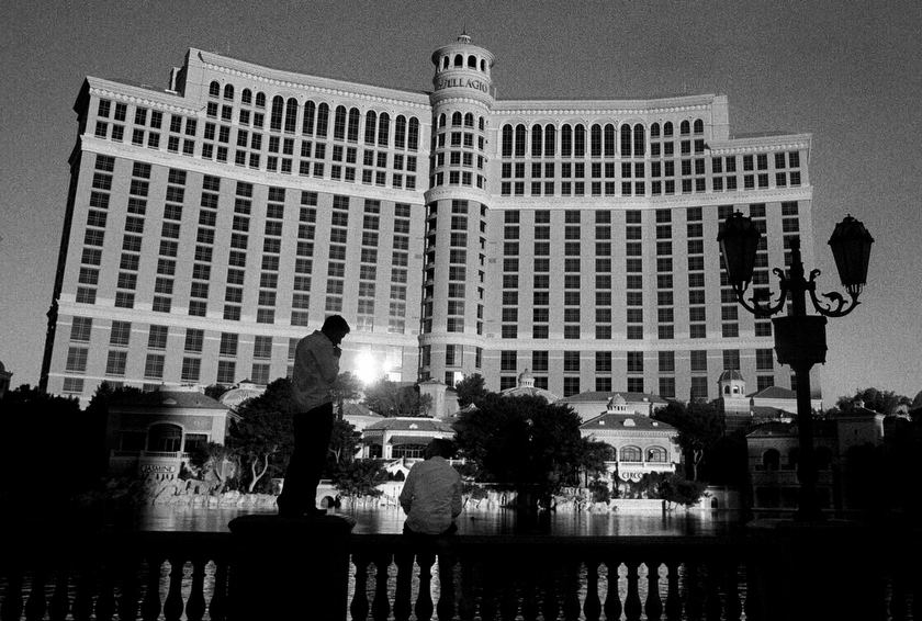 The Bellagio Hotel, a 30 story luxury hotel with a surrounding 8.5 acre lake sits in the middle of the desert in Las Vegas Nevada. The fountains of the Bellagio cost an estimated $75 million to create, and spray the waters of the Colorado to entertain tourists.  Inquire about this image