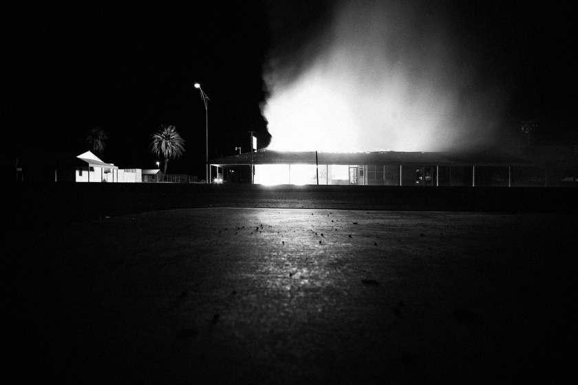 A fire destroys a business in the Salton Sea area of the Imperial Valley in California. The business was one of the last businesses standing in the mostly deserted area that was once a thriving tourist destination, but deteriorated as the sea, which was created by the Colorado River, died from pollution and dried out from the effects of global warming.  Inquire about this image