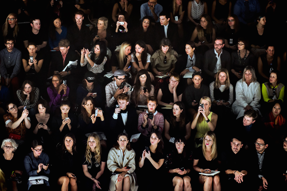 A crowd of attendees watches the Issey Miyake runway show at Paris Fashion Week, Spring 2014.   Inquire about this image
