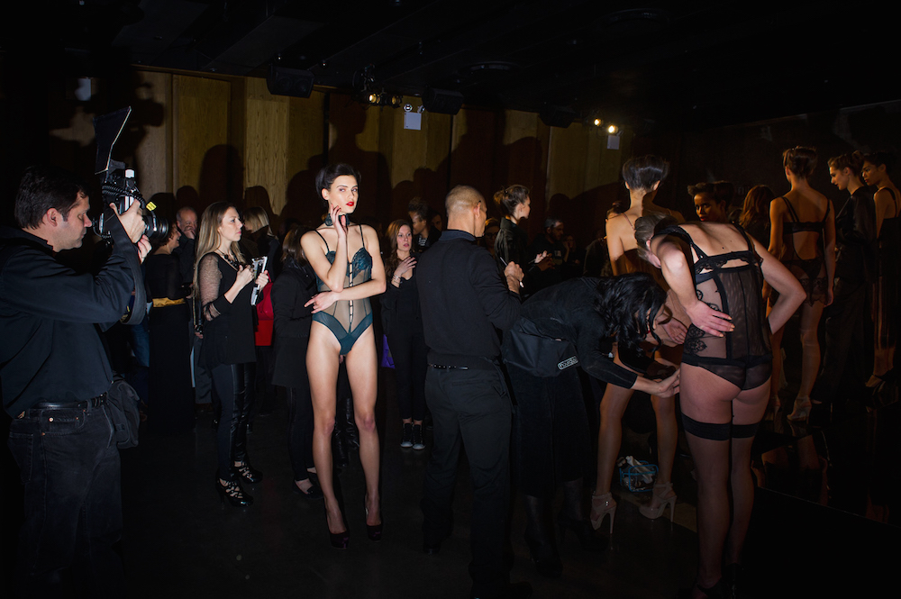 A model poses for a photographer at the La Perla Fall 2013 lingerie presentation at the Dream Hotel during Mercedes-Benz Fashion Week in New York City.  Inquire about this image