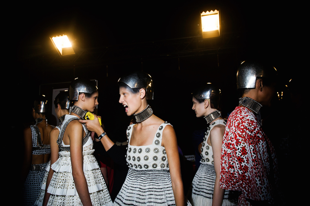 Models wait backstage at the Alexander McQueen fashion show. Paris Fashion Week, Spring 2014.  Inquire about this image