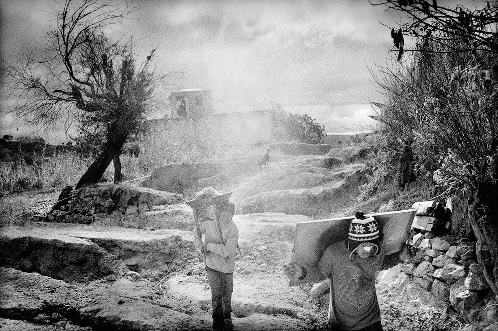 Removing possessions from a destroyed village. Santiago Mitlatongo, Mexico. 2011.   Inquire about this image