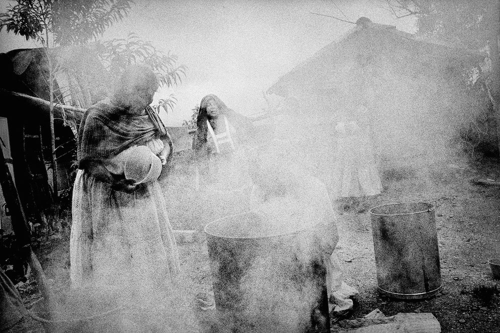 Cooking food for a wake. San Miguel Cuevas, Mexico. 2000.   Inquire about this image