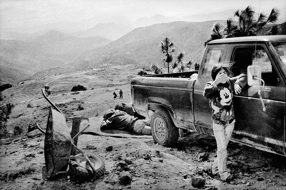 A family rests alongside a road. Santiago Mitlatongo, Mexico. 2011.   Inquire about this image