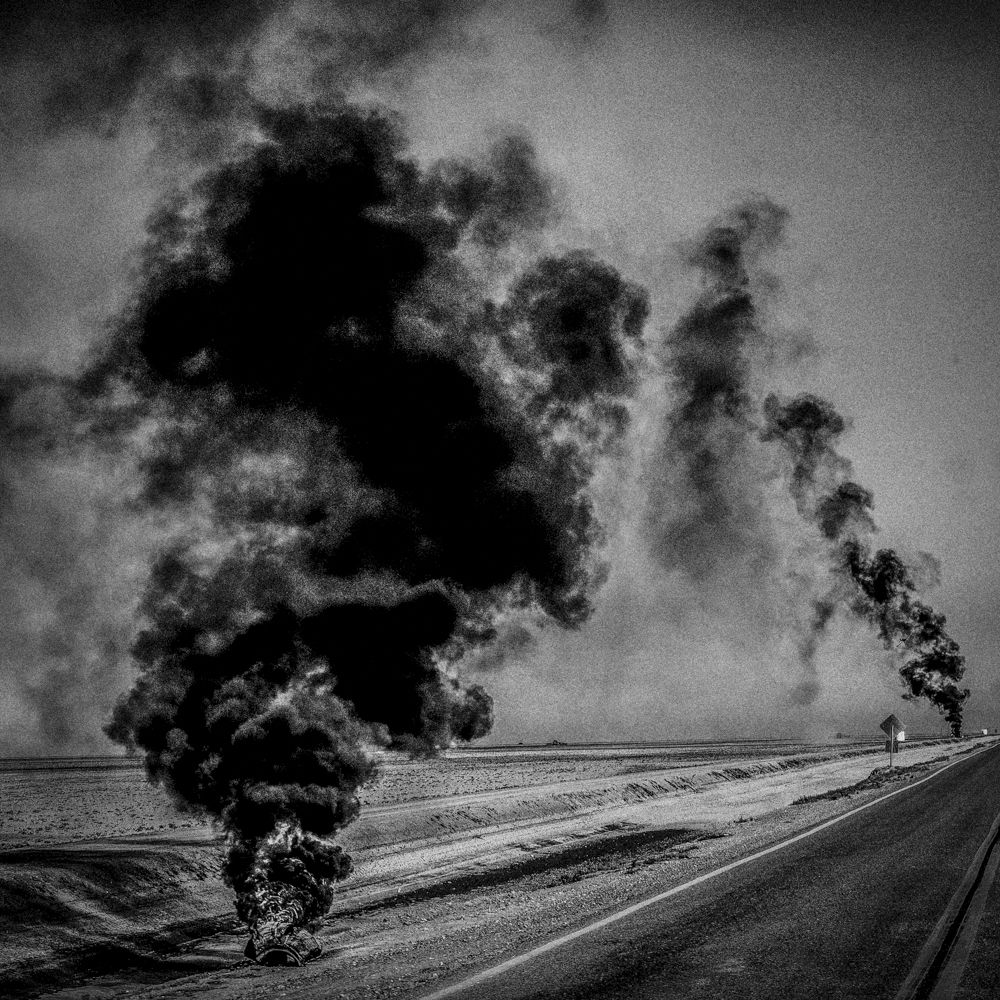 Burning tires. Corcoran, CA.   Inquire about this image