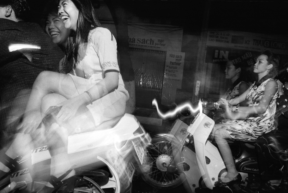 Motorbike cruising has become the number one activity of Saigon's youth, especially as there is little else for the cash poor youth to do. 1994.   Inquire about this image
