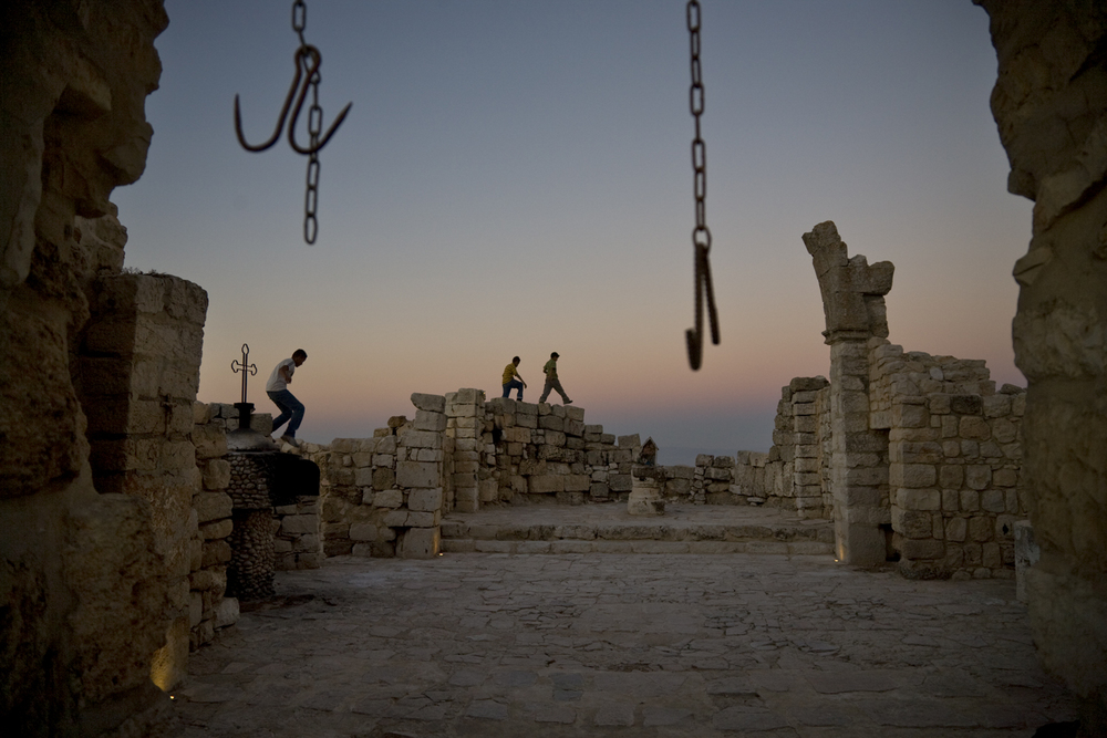 Dusk settles around the ancient Byzantine church ruins in the town of Taybeh, the only completely Christian town left in the West Bank. July 2008.   Inquire about this image