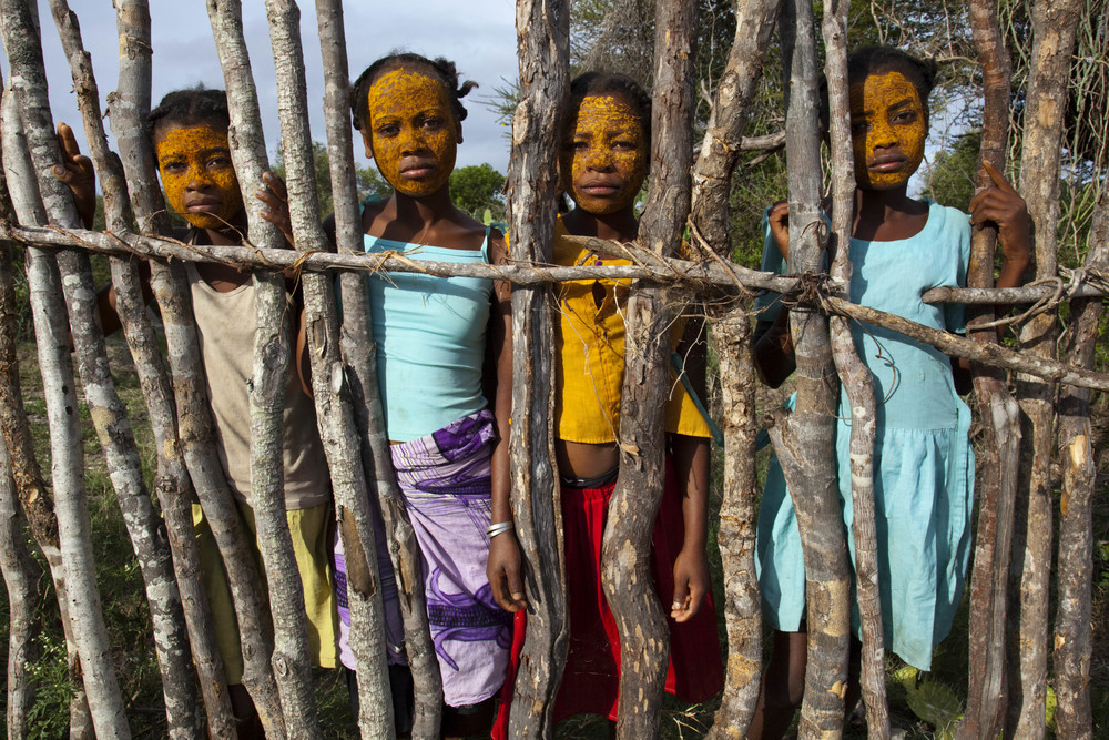 Adolescent Malagasy girls with beauty mud on their faces, Madagascar, January 2010.   Inquire about this image