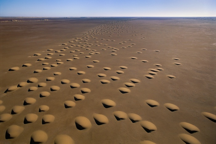 Dot-formed barchan dunes, Ramlat Hazar, Yemen, 2004.   Inquire about this image