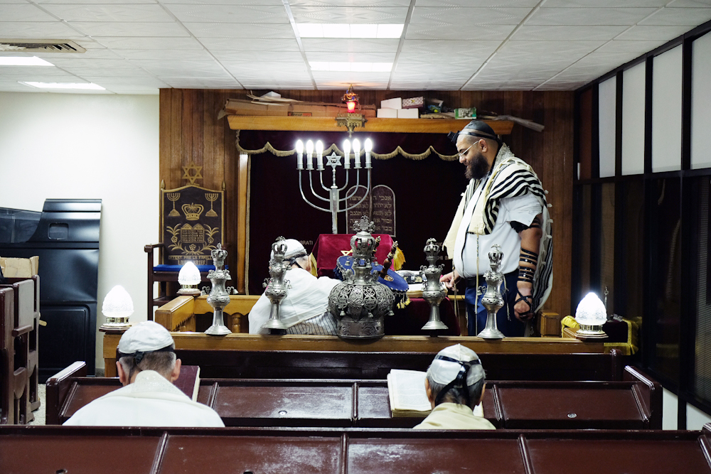 The Rabbi of the Sefarati Synagogue presides over a service.  Inquire about this image