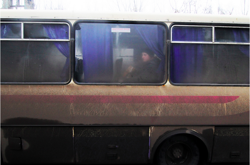 February 6, 2015, Debalseve, Donbass Oblast, Ukraine. A few locals have boarded a bus to escape the battle around their town.