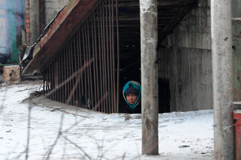 February 9, 2015, Debaltseve, Donbass Oblast, Ukraine. A woman takes refuge as the area is under shelling attacks from separatists forces.