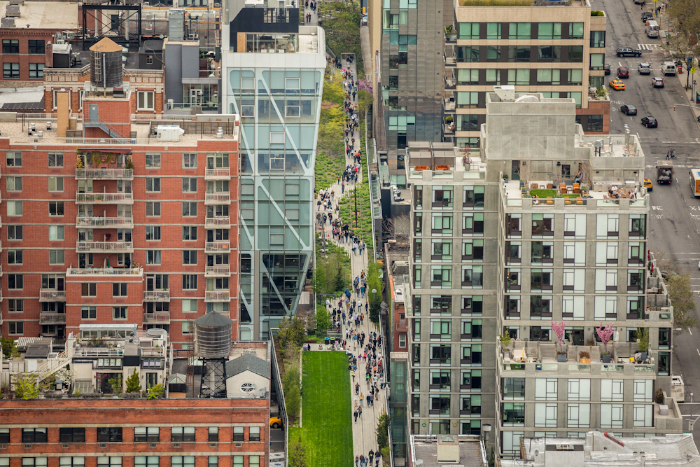 Looking north up the High Line near W. 23rd Street and 10th Ave. in New York City on a Saturday afternoon in early spring. May 2014.   Inquire about this image