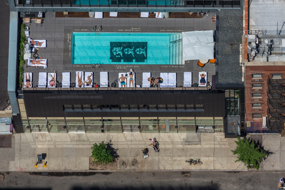 "The Sixty LES Hotel, at 190 Allen Street, boasts an ""Andy Warhol filmstrip pool"" on the roof. July 2014.   Inquire about this image"
