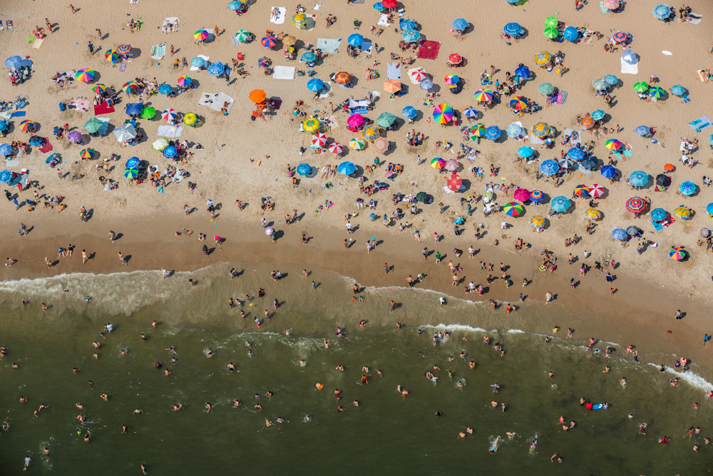 Beachgoers soak in the sun in Coney Island, Brooklyn, on Labor Day Weekend. August 2014.   Inquire about this image