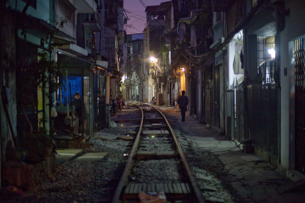 A view of a slum neighborhood along the railroad tracks in Hanoi, Vietnam.  The country's economy is still growing at seven percent, but double-digit price increases in food and other essentials are hurting the working class.  Inquire about this image