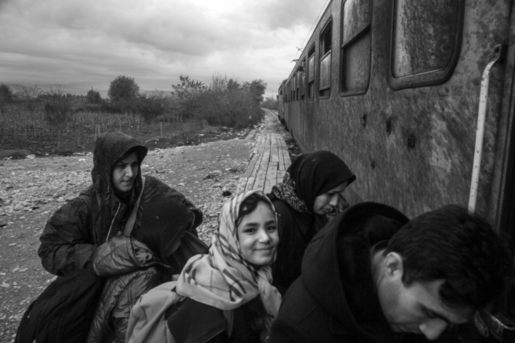 November 2015, Refugees from Afghanistan, Syria and Iraq are permitted to board a train that will take them from a Macedonian transit camp on the border with Greece to another camp on the border with Serbia, from where they must travel on foot to Serbia. Refugees pay 25 Euros for an unheated, overcrowded train ride that lasts about 4 hours and crosses all of Macedonia.