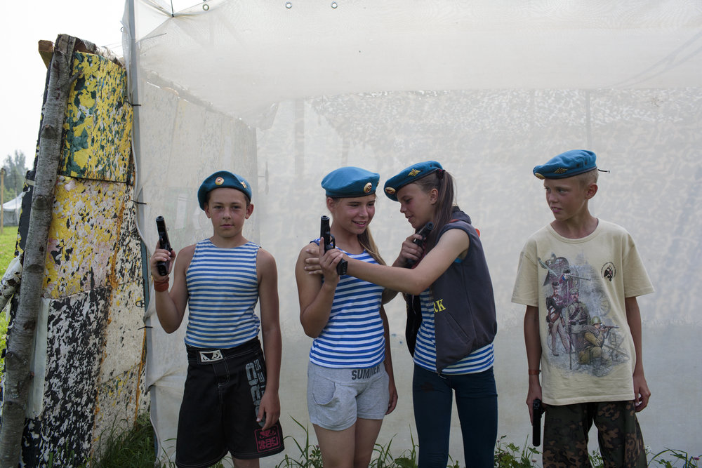 Students dressed in traditional hats and shirts of the Russian air-force pose for a portrait during a firearm drill at Исторический Лагерь Бородино 2016, the Historical-War Camp in Borodino, Russia.   Inquire about this image