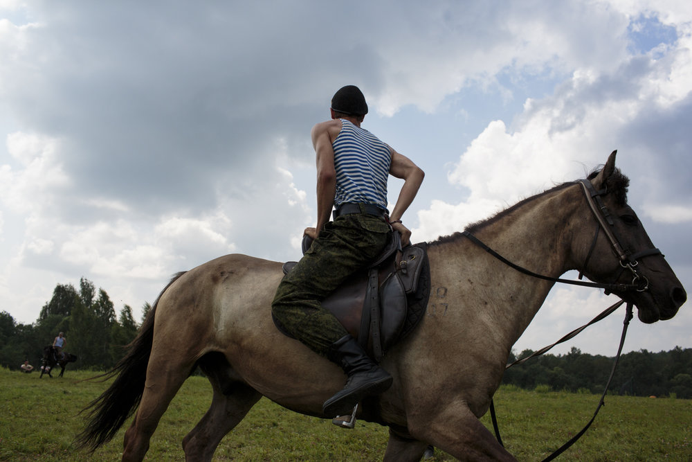 Students train in horseback riding at Военно-Исторический Лагерь Бородино 2016, the Historical-War Camp in Borodino, Russia.  Inquire about this image