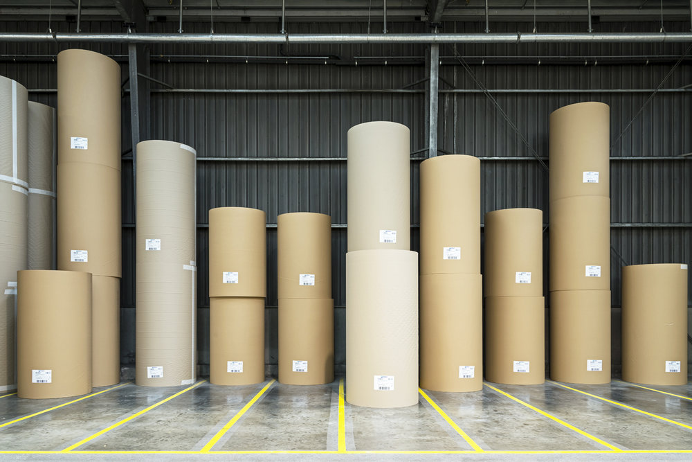 Rolls of paper entirely produced from recovered cardboard and paper, ready to be transformed into corrugated cardboard or other packaging material. Paper fiber can be recycled this way up to seven times.  Inquire about this image