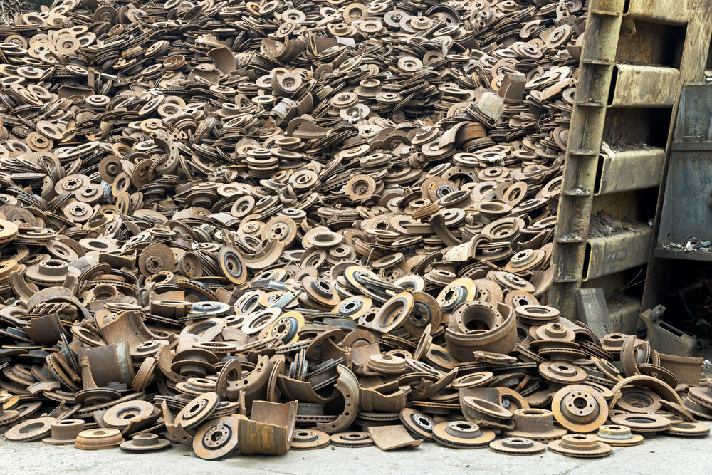 Steel disk brakes, obtained from dismantling discarded cars, going to steel mills for reprocessing into new steel.  Inquire about this image