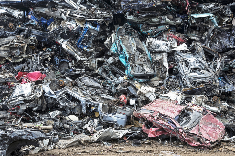 Dismantled automobiles waiting to be shredded. The metal fraction will go to steel plants for the production of new steel. The remaining fraction goes to a specialized plant for further manipulation and breakdown into different components.  Inquire about this image