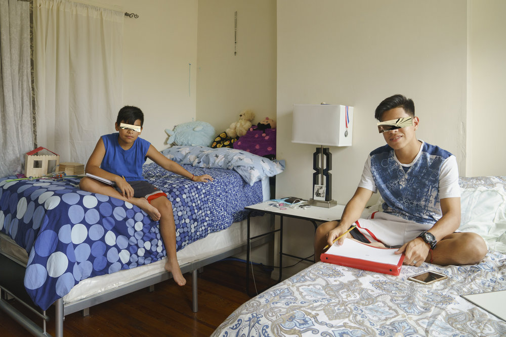 Little and Junior arrived at ages 12 and 15. Children whose legal cases were unresolved at the time the image was made may be wearing reflective privacy masks.
