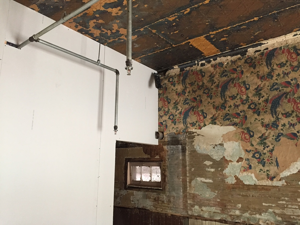 A new wall abuts the original 19th century bead board wall with early 20th century wallpaper remnants. A historic renovation fanatic's dream in Hortonville, WI! thematchfactory.org
