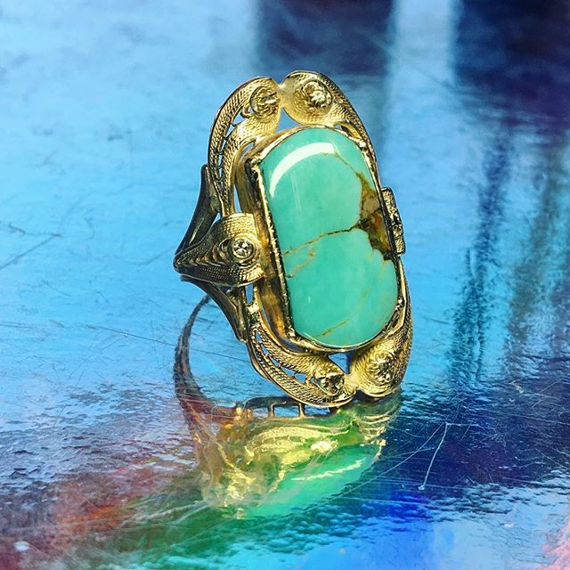 Antique jewelry always has a story to tell. This 10k filigree ring had a chipped old cameo and barely a seat to set it on. I built a new seat, soldered it in very carefully and slowly to avoid melting any of the filigree. my friend @nhunter398 custom cut the turquoise rough to fit, and i tucked a wee diamond into a missing ornament, for good measure. She's a fragile beauty, but, with care, should last another generation or so. I'll try and dig the before photo out of the cloud for ya. 😎💎🥶🖤🤞🏼 . #antiquering #filigree #jewelryrepair #turquoiseandgold #heirloomjewelry #jewelryrestoration #goldsmith #craftswoman #buylesschoosewell #repairnotreplace #sentimentaljewelry #jewelrymakeover #meaningfuljewelry