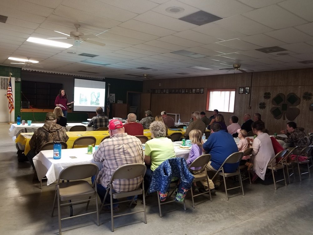 Invasive Technician Heather Zengler talks to Gibson and Pike county residents about local invasive plants. Photo by Emily Finch (SICIM).