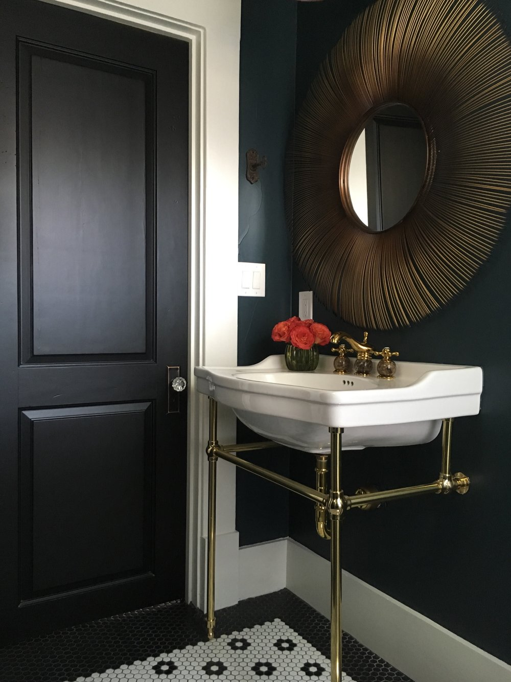 Navy and black powder bath in historic home