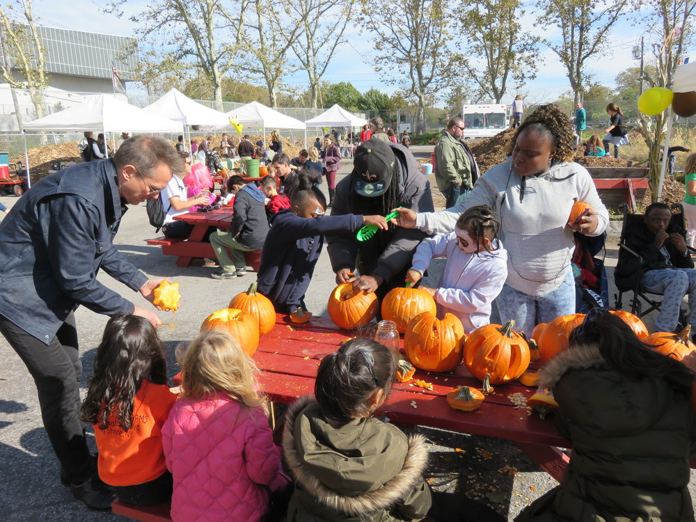 Pumpkin carving and other festivities at Harvest Festival 2016.