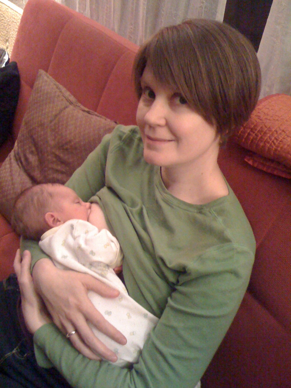 This is me, 7 years ago, sitting on the couch and nursing my baby while my parents, sisters, and husband did ALL the things in the list above. Except caring for older children, cause this little guy is my one and only!