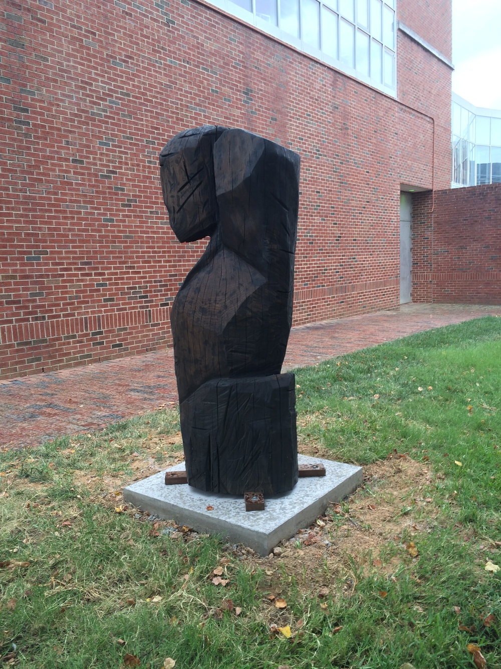 Totem n. 39 (For NC Woodworkers) , installation view  NC white oak, graphite, and tung oil  32 inch diameter, 72 inches tall, 2014-15  Commissioned by UNC-CH Art Department