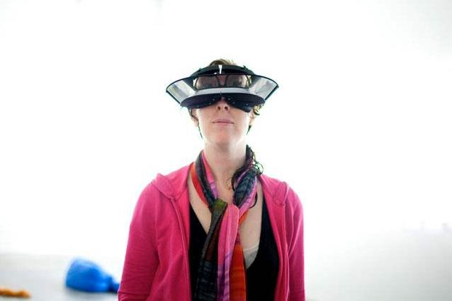Paddy Johnson wearing Carsten Höller's goggles that turn everything you see upside down. New Museum, 2011. Image credit: Katie Sokoler