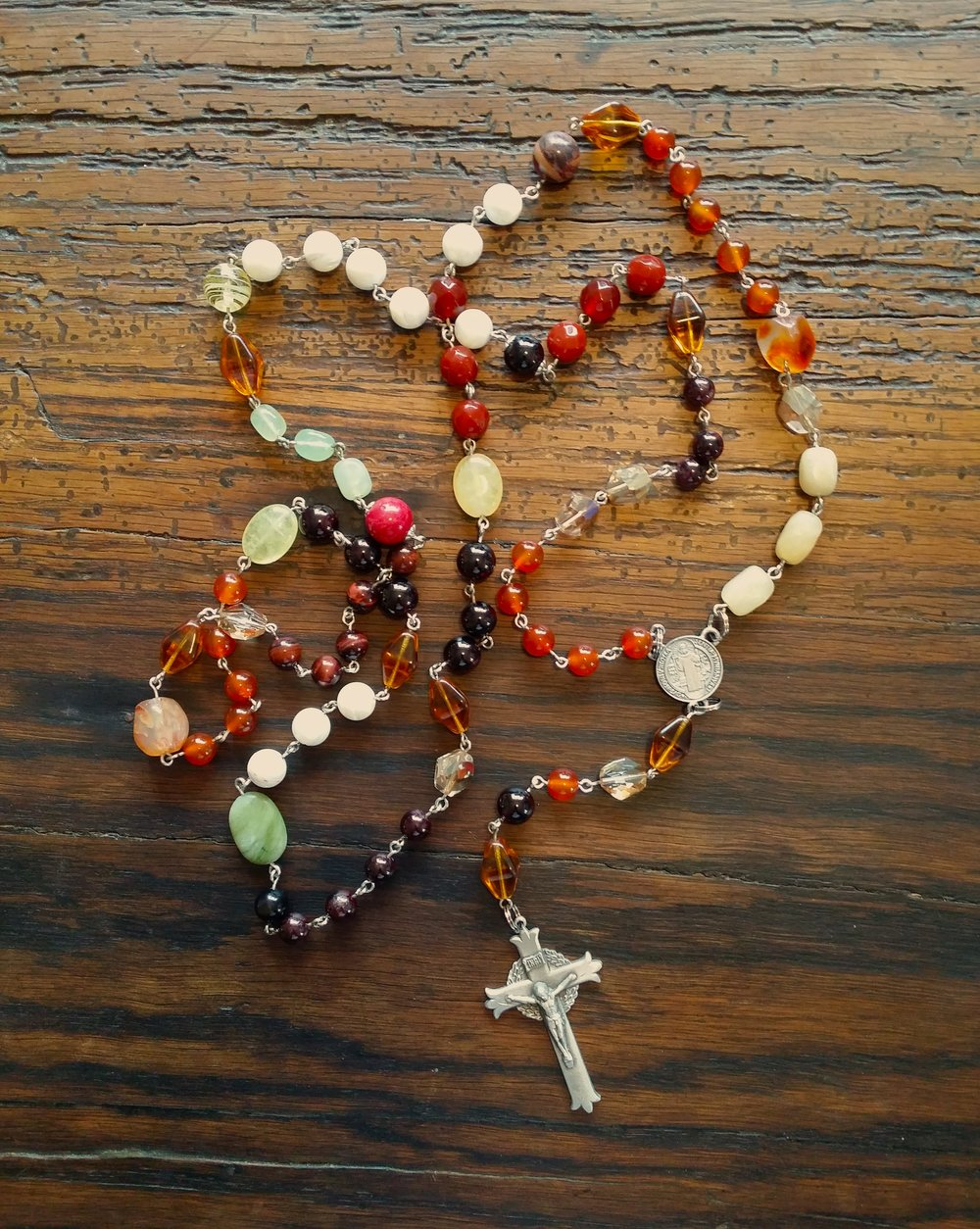 Seven decade Root and Sacral Chakra Rosary of garnet, red tiger eye, mother-of-pearl,  three types of carnelian, fire polished glass and Swarovski crystal, and sea jade.
