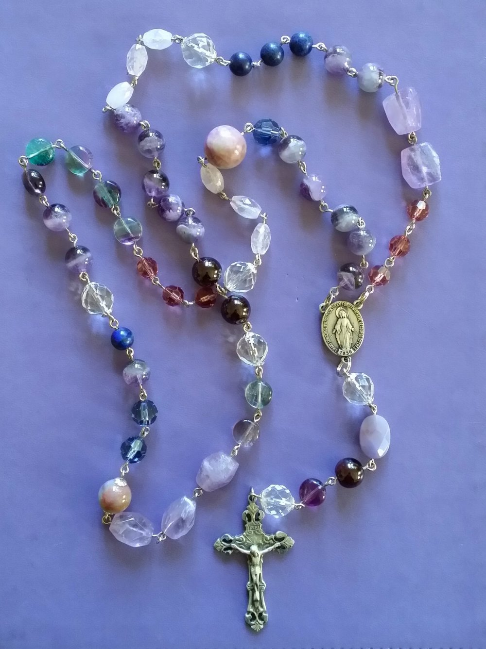 We offer finely crafted traditional five decade rosaries, seven decade Chakra rosaries, and seven decade Franciscan Crown rosaries.
