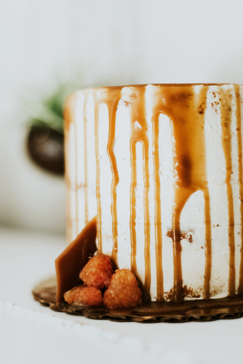Vanilla bean cake, bourbon buttercream with sunshine raspberries & caramel drip   M2 Photography