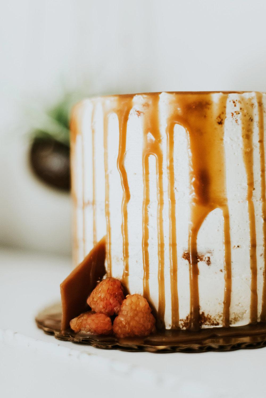 Vanilla bean cake, bourbon buttercream with sunshine raspberries & caramel drip   M2 Photography
