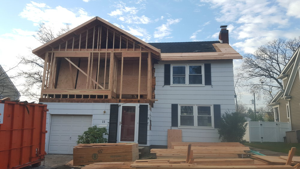 New Front Addition and roof overhangs add space and curb appeal