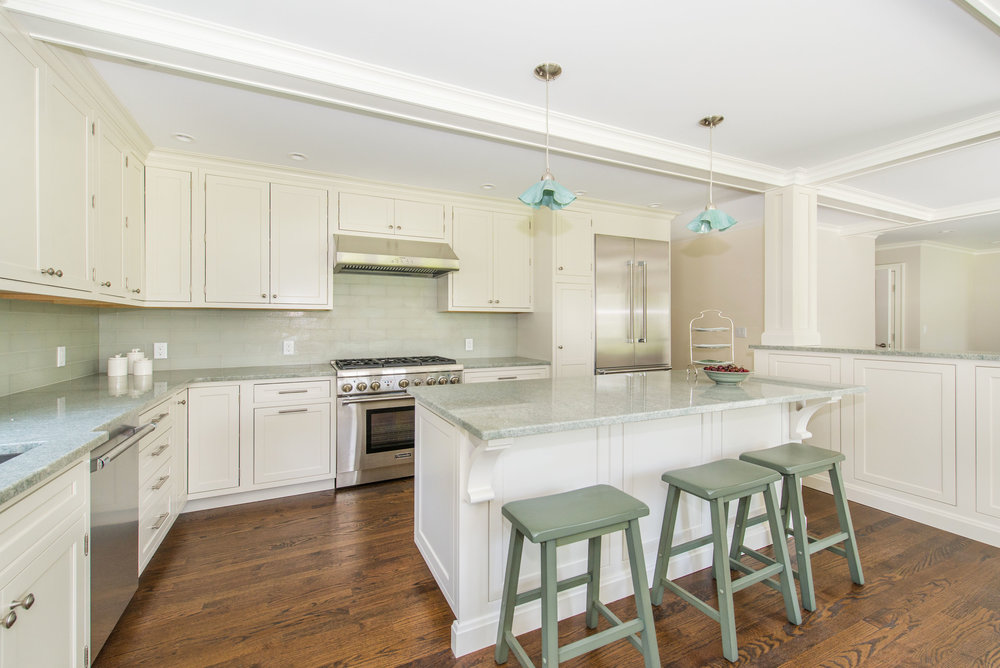New Kitchen features inset Decora Cabinets, Energy Star Thermador appliances and Costa Esmeralda granite countertops