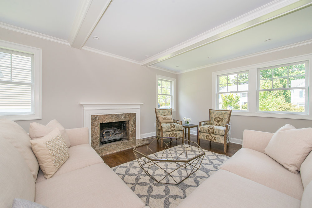 New Living Room is larger with gas insert fireplace and coffered ceilings